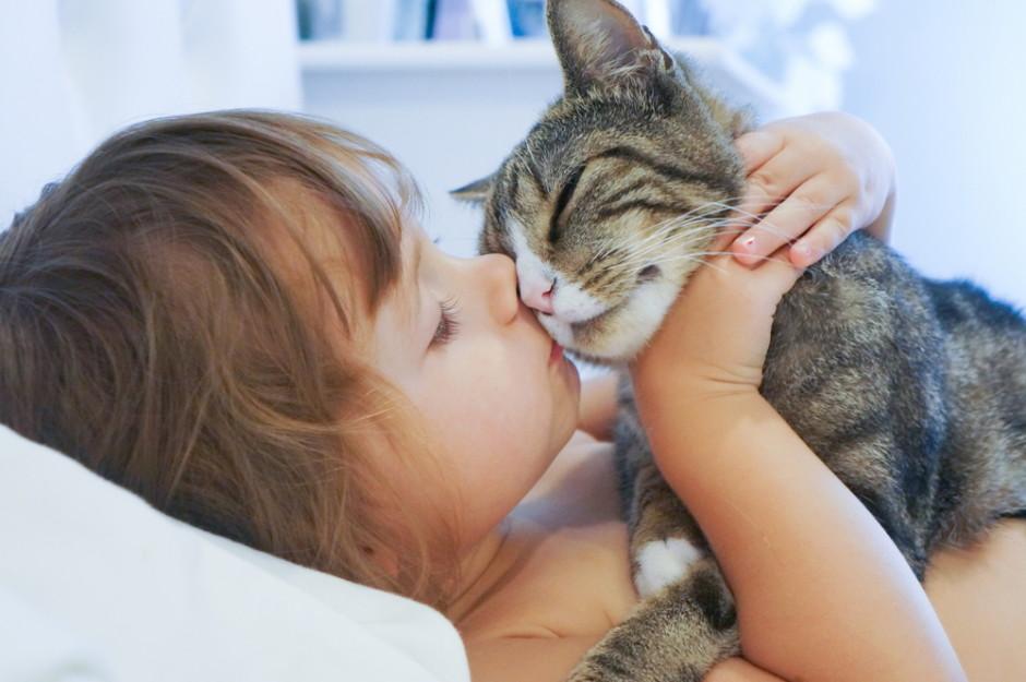Girl loving her cat-Signs Cat Loves You