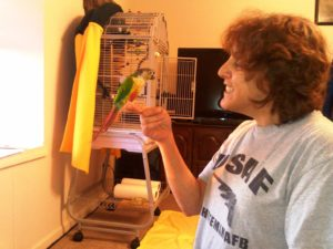 Pet Sitter with Conure bird